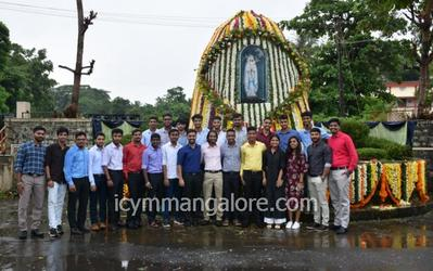 ICYM Bajpe unit holds cleaning and decoration of Mother Mary Grotto